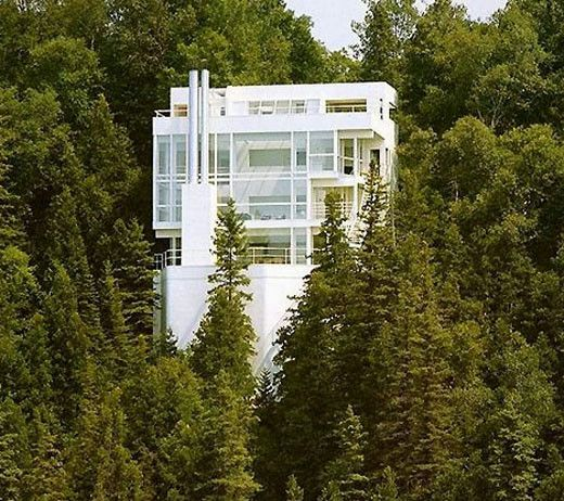 Completed in 1973 in Harbor Springs, United States. Hovering over the shores of Lake Michigan, the Douglas House was built by Richard Meier in 1971-1973 for Jim and Jean Douglas. The house is gently...