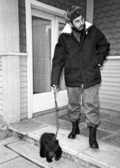 Castro walking a rescued bear