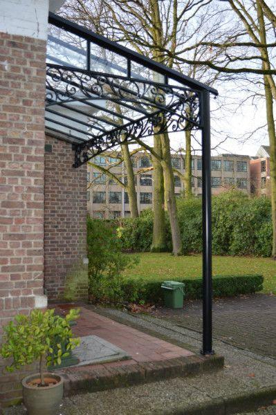 Brasschaat-kleine deuroverkapping steunend op 1 ro…