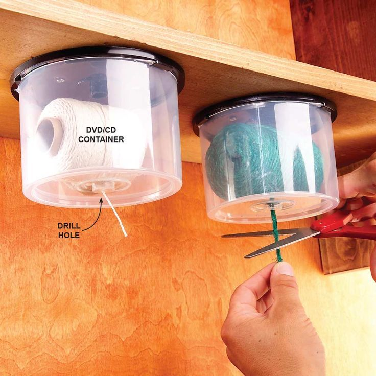 Here's a great way to reuse empty CD/DVD containers. Drill a hole in the top for the string to slide through, then screw the lid under a shelf and snap on the string-loaded container. Pull down and snip off the desired length and never worry that your ball of string will roll away across the floor dragging its tail behind it!