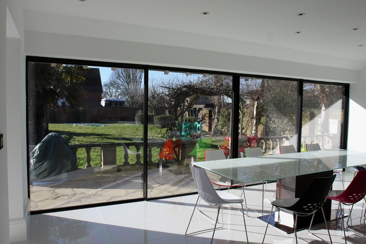 2 sliding and 2 fixed Minimal Windows by IQ Glass