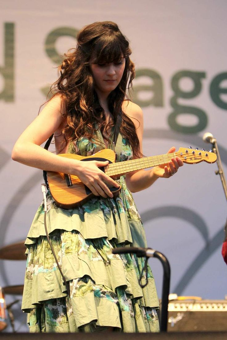Zooey Deschanel-Playing the Ukelele! I read that she actually knows how to play it! So cute. (: