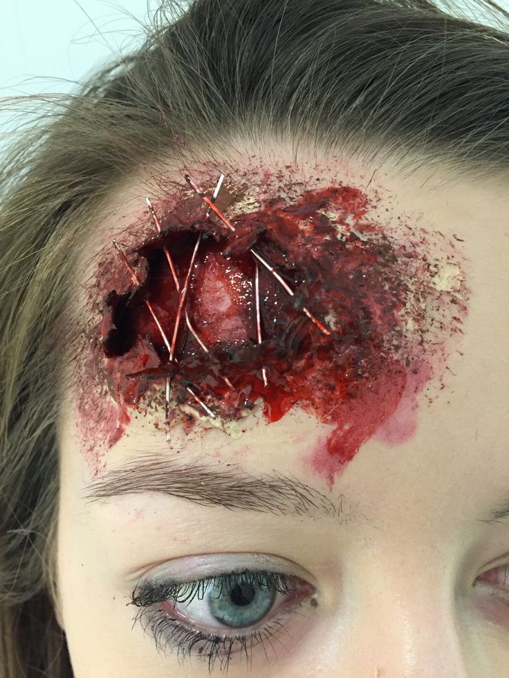 SFX makeup liquid latex prop close up head wound.  Model: Connie Green