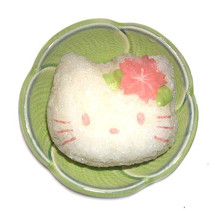 Hello kitty sakura onigiri. Decorated with mamenori (soy paper). For the flower I used a sakura veggie cutter and then cut the stamens using scissors. The leaf cutter is from a set meant for polymer clay, but I use them just for food.