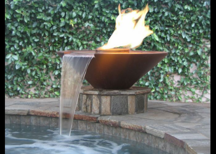 Fire and water spill over fountain pool fountains for Garden pool fountains