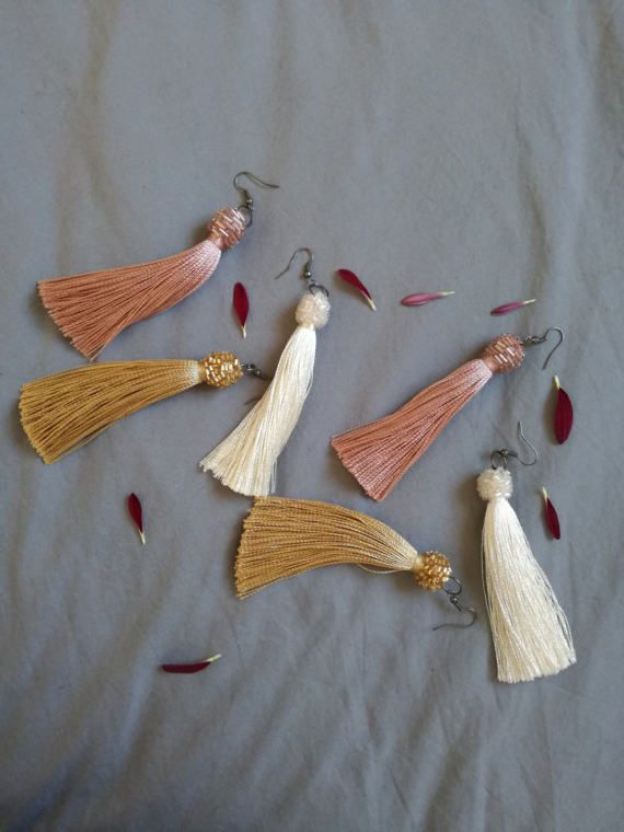 Check out this item in my Etsy shop https://www.etsy.com/listing/505606190/tassel-earrings-gold-ivory-rose-quartz