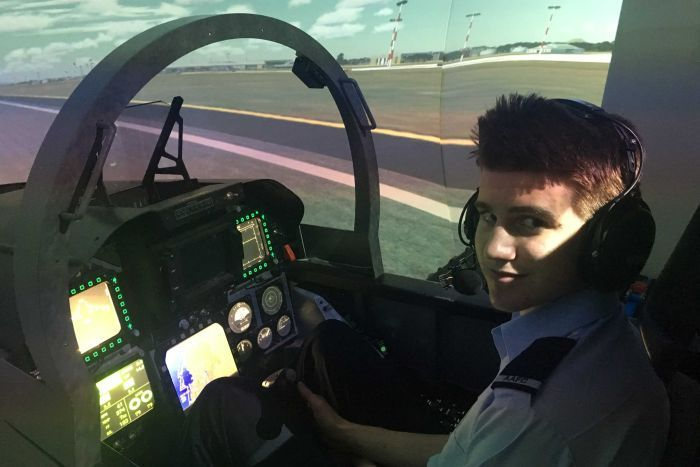 Air Force cadet in F/1-18 flight simulator