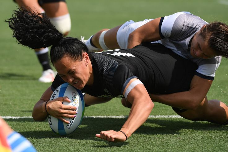 New Zealand's Portia Woodman (L) is tackled by France's Camille Grassineau as she scores a try in the womens rugby sevens match between New Zealand and France during the Rio 2016 Olympic Games at Deodoro Stadium in Rio de Janeiro on August 7, 2016. / AFP / Pascal GUYOT