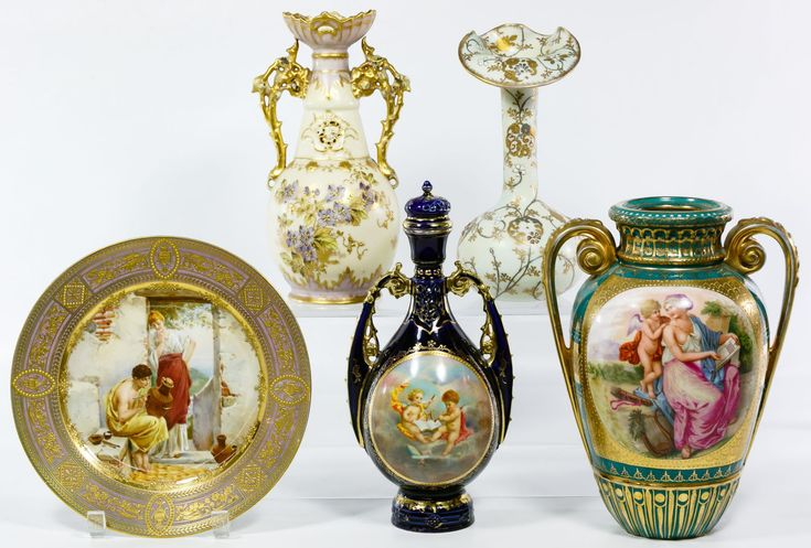 Lot 275: Ceramic Assortment; (5) items including a cobalt blue decanter with gold decoration, a moriage decorated Asian vase with folded rim, a Hungarian moriage vase with foliate handles, a hand painted plate featuring two figures and a vase with printed cupids