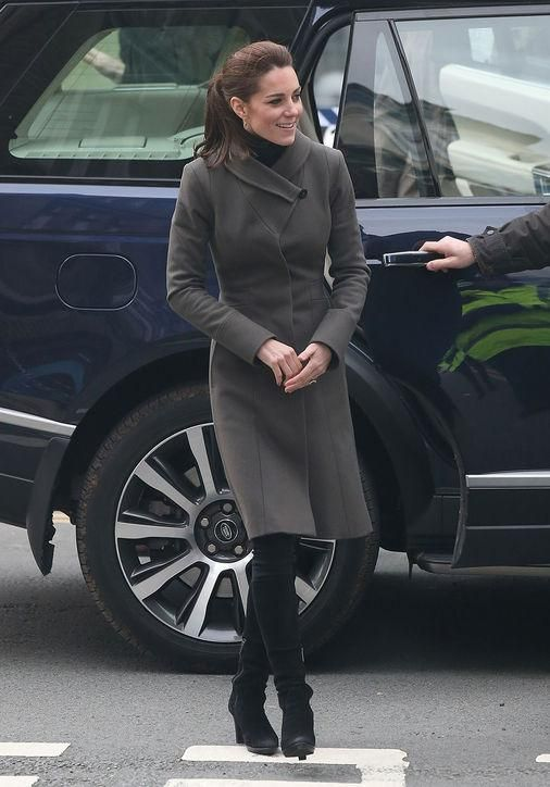 Notice anything different about Kate Middleton's outfit? She finished off her army green Reiss coat and knee-high boots with...leggings!
