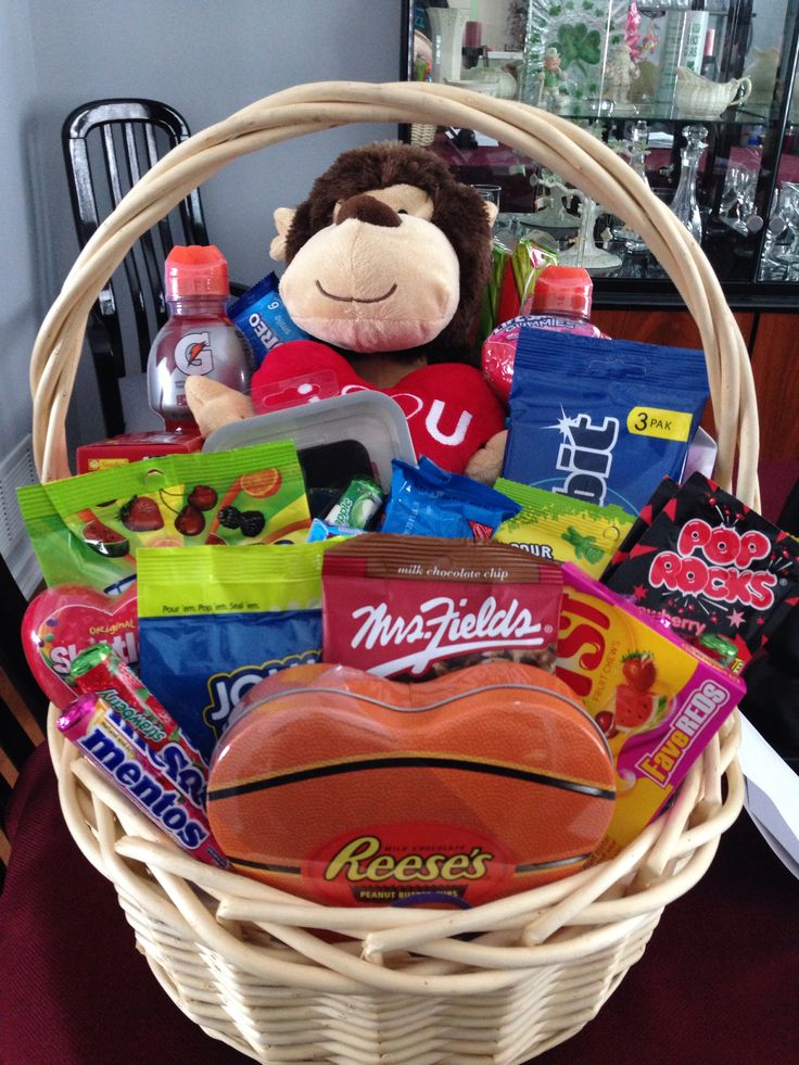 Basket I made my boyfriend for Valentines Day with candy, snacks, lottery tickets, gift cards and more!