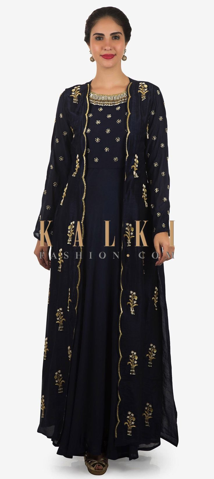 Buy Online from the link below. We ship worldwide Click Anywhere to Tag Navy blue tunic matched with embroidered full sleeve jacket only on Kalki  Here is this contemporary outfit you'll definitely fall in love with. This tunic in silk showcases the beautiful shades of blue. It is paired with a embellished jacket than is enhanced in embossed sequin work with zardosi embroidery. The outfit the perfect pink for your ideal brunch parties. Slight variation in color is possible.