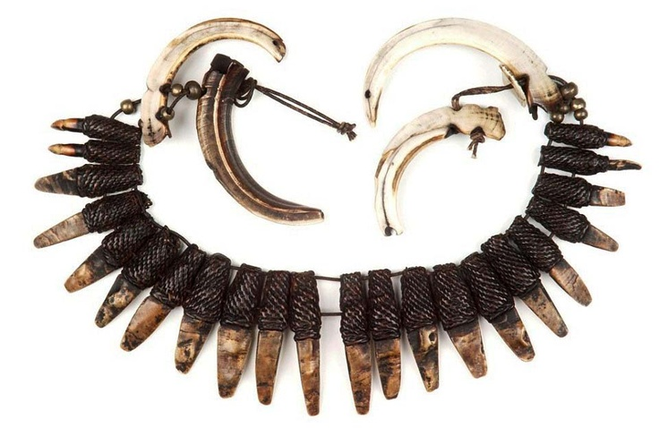 Philippines ~ Ifugao | Warrior's necklace from the Bontoc people of the Cagayan valley | Pieces of shell cut into the shape of animal teeth, fiber and two wild boar tusks.