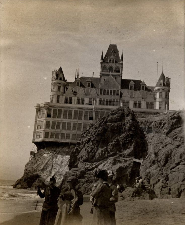 "Victorian Cliff House:  ""Cliff House has had five major incarnations since its beginnings in 1858. In 1896, Adolph Sutro built a new Cliff House, a seven story Victorian Chateau, called by some ""the Gingerbread Palace"", below his estate on the bluffs of Sutro Heights. Great throngs of San Franciscans arrived on steam trains, bicycles, carts and horse wagons on Sunday excursions.    The House burned to the ground on the evening of September 7, 1907″"