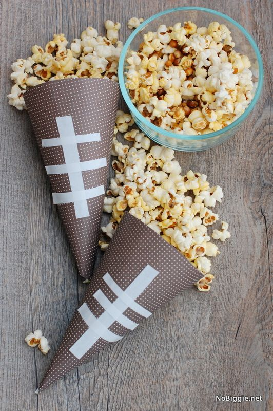 Get ready for game day the right way with football party décor crafts like game play cups and football paper cones for popcorn. Click in to see No Biggie's festive game day decorations.