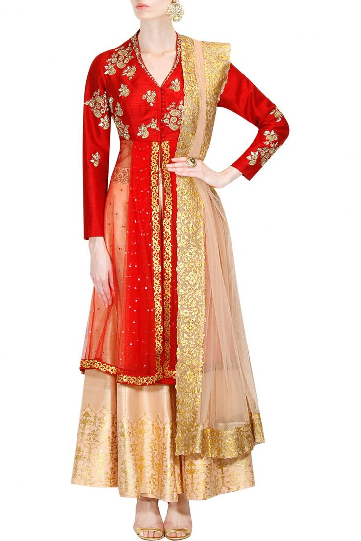 This red colour sharara setfeatures in velvet handcrafted with gold and silver sequined and embroidered floral and leaf motifs around the border, neckline and