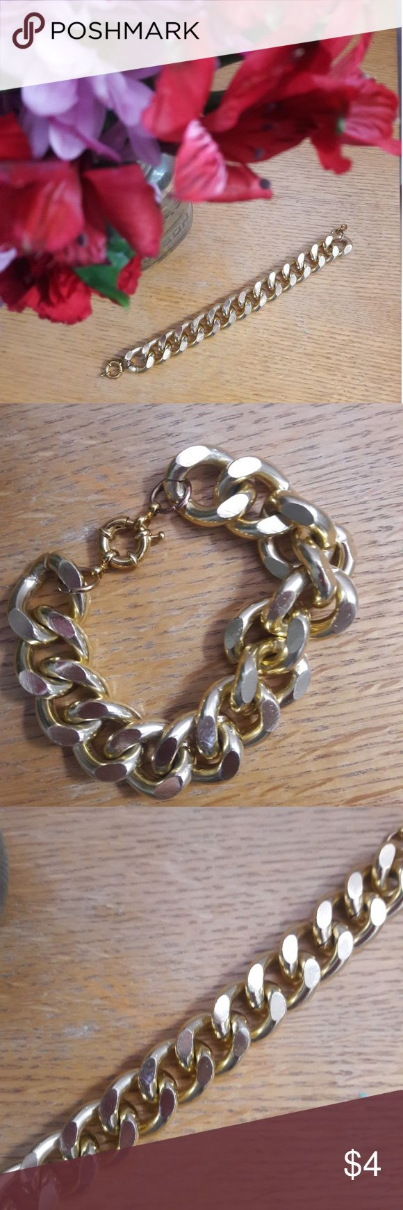 Gold chain link bracelet Gold colored chain link bracelet from Etsy. Large fit with a clasp. Very cute basic to have on hand that looks great dressed up or down. Jewelry Bracelets