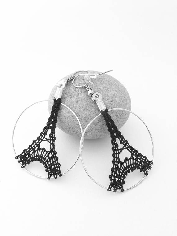 Bobbin of Eiffel Tower hoop earrings. Designed and made by me in bobbin lace. The Lacers crocheted while working on a metal Hoop and rigid to provide support and protection. These earrings are very light and so comfortable to wear. They are dressed with elegance any outfit. Eiffel