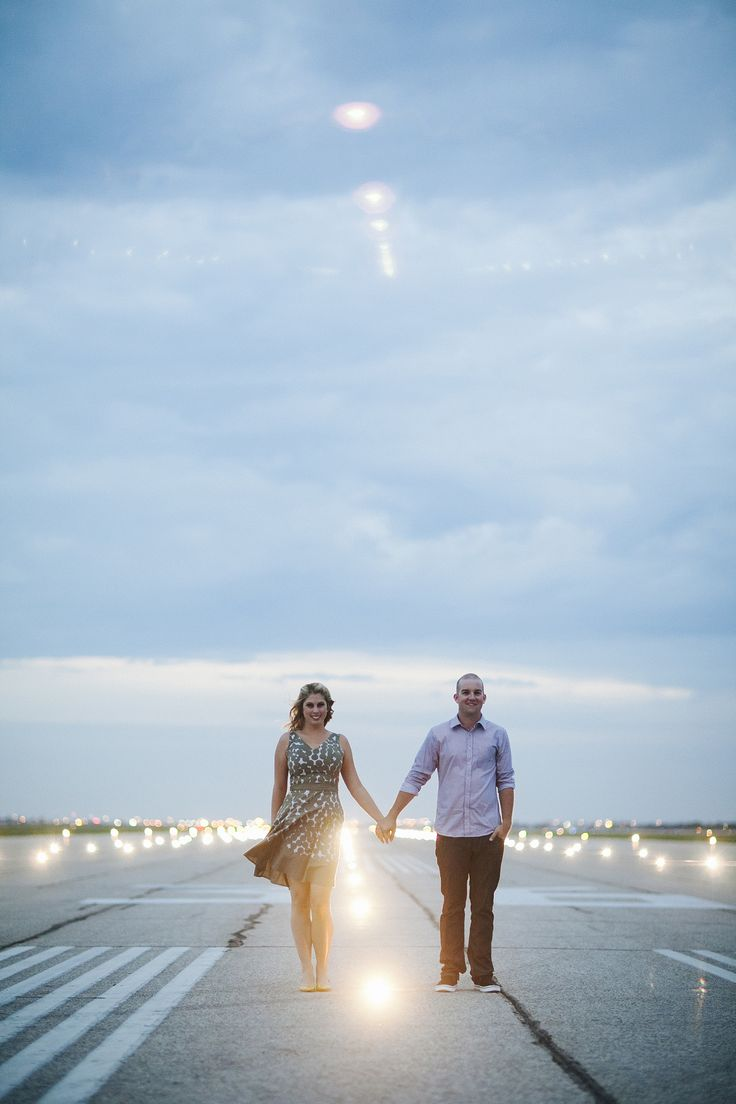Canadian airport runway engagement shoot. Josh Dookhie Photography.  Read More: http://www.stylemepretty.com/canada-weddings/manitoba/winnipeg/2014/01/15/runway-romance-engagement-session/