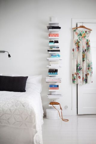 Small bedroom decor: When there's little room to go wide, use the height of the room to your advantage. A free-standing case (or a series of compact wall-mounted shelves) provides ample storage space without compromising valuable square footage.