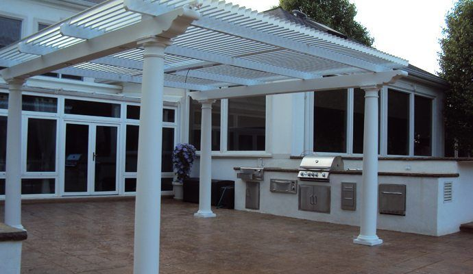 Louvered Awnings Shade And Shutter Systems Inc New England Massachusetts Cape Cod Long Island And Connecti Pergola Pergola On The Roof Louvered Pergola