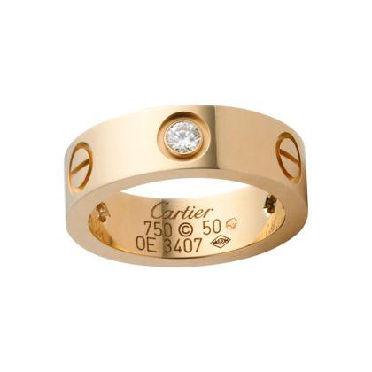 Cartier LOVE ring, 18 karaat geelgoud met 3 diamanten. Model OE 3407.