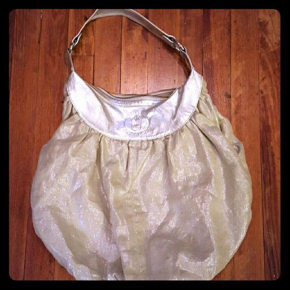 Armani Exchange Purse Leather/cloth silver Armani Exchange purse. Very spacious. Armani Exchange Bags Shoulder Bags