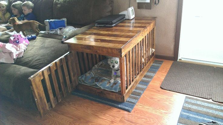 A Coffee Table Dog Kennel Built Out Of Pallet Wood