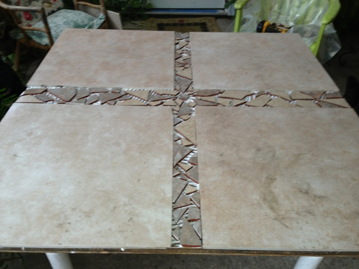 Turning an old table into a lovely outdoor table with left over tile.