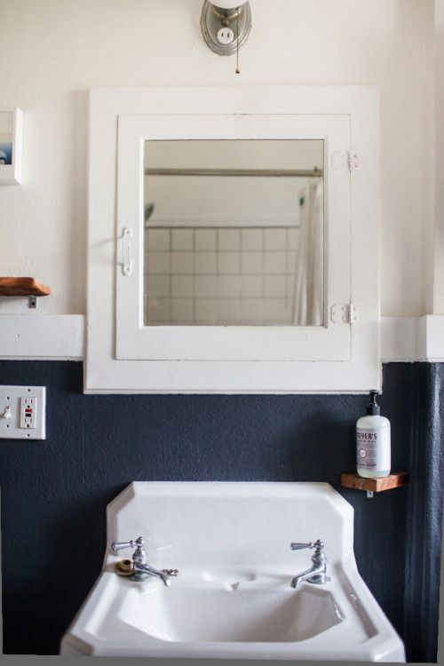 Bathroom with black wall below picture rail and white above.  Clean and warm, two bathroom essentials.  Love it.   Design*Sponge | Leah Verwey Photo