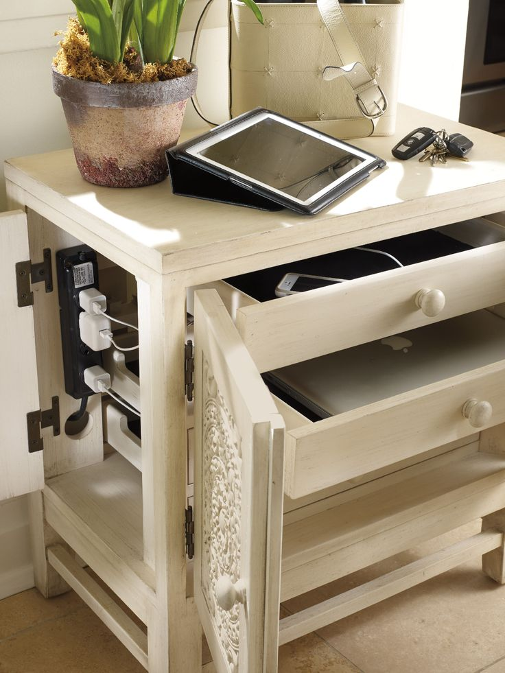 Crafted from Poplar and hardwood solids with resin this E-Charge Center features two doors with four drawers.
