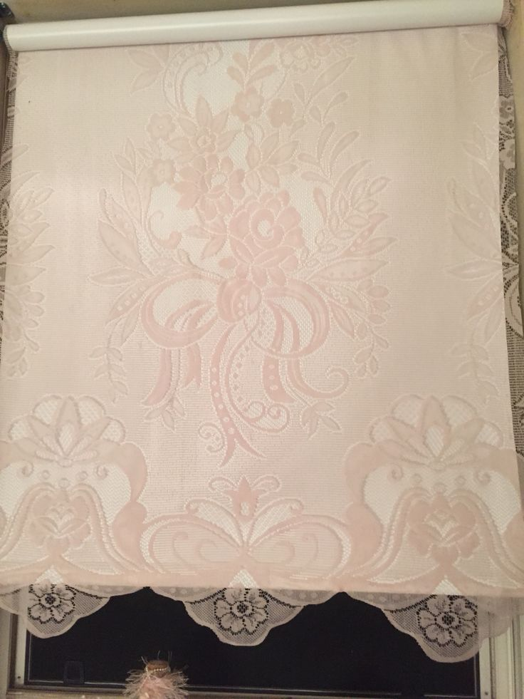 Lace covered roller blind