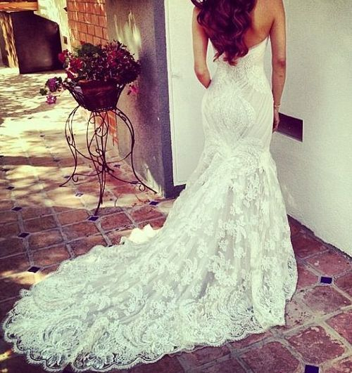 This dress is absolutely beautiful! Love the lace!