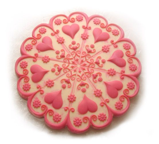Lovely cookie/candy mold for purchase here.  It's not cheap, but is so beautifully elaborate.