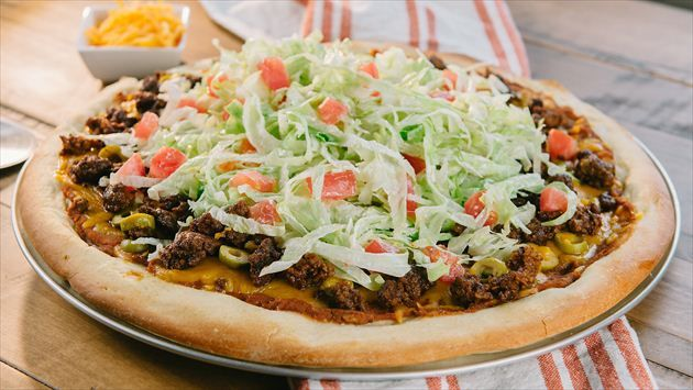 Get this all-star, easy-to-follow Garth's Taco Pizza recipe from Trisha Yearwood