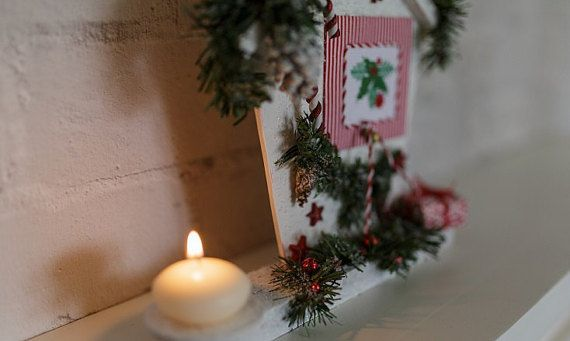 New house with embroidery and candle.  Christmas candle fill your home with warmth and comfort. Light the candles, turn off the lights and enjoy the festive atmosphere of warmth and family comfort.  MATERIALS ---------------------------------- ● Stand made of wood covered with paint ● paraffin candles and natural bumps ● Cross stitch ● Artificial spruce twigs, decorative ribbons   ---------------------------------- SIZE ---------------------------------- ● Height 23cm. (~ 9 inches) ● The…