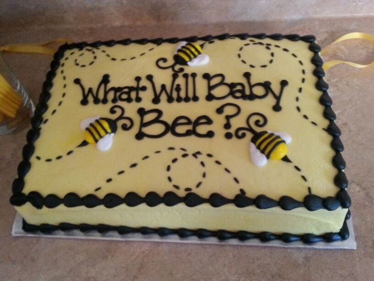 Our 'What Will Baby Bee?' Gender reveal cake pull. We had 'It's a boy' charms tucked under the cake and the cake inside was blue.