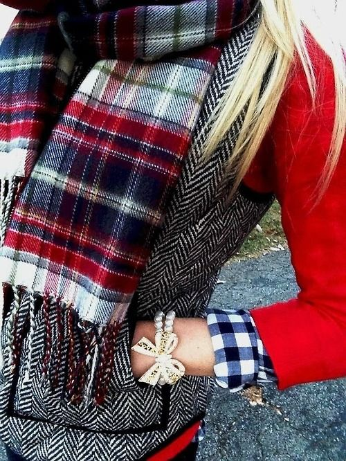 plaid scarf. gingham button down. herringbone winter vest. red cardigan. pearl bracelet with bow detail.