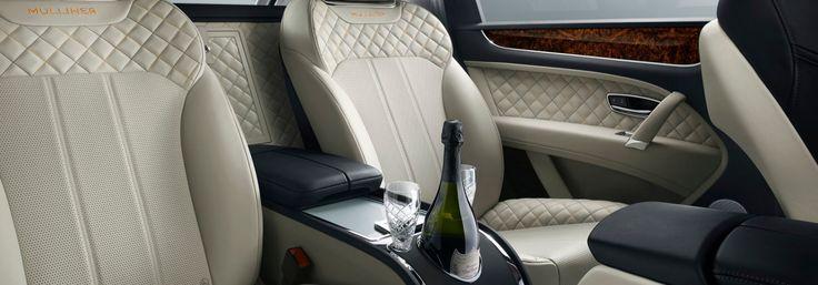 Rear seats with car bottle cooler insider the Bentley Bentayga Mulliner   Bentley Motors