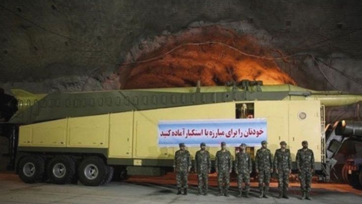 Iran's underground missile base   Jeremy Binnie, London - IHS Jane's Defence Weekly 22 October 2015   Iranian personnel stand next to a Ghadr ballistic missile on its TEL inside the underground facility. Source: Fars News Agency    Key Points  Iran has provided a rare glimpse inside one of its underground missile bases The base could be temporarily neutralised if its entrances were bombed  Iranian state television broadcast new footage from inside an underground base on 14 October that…