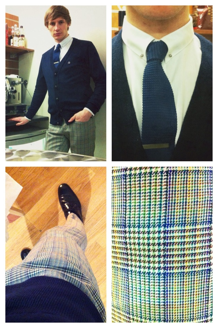 White Pin Collar Shirt - Navy Wool Cardigan w/Leather Buttons - Green Check Frogmouth Trousers - Black Brogues - Blue Knitted Tie - Silver Tie Pin