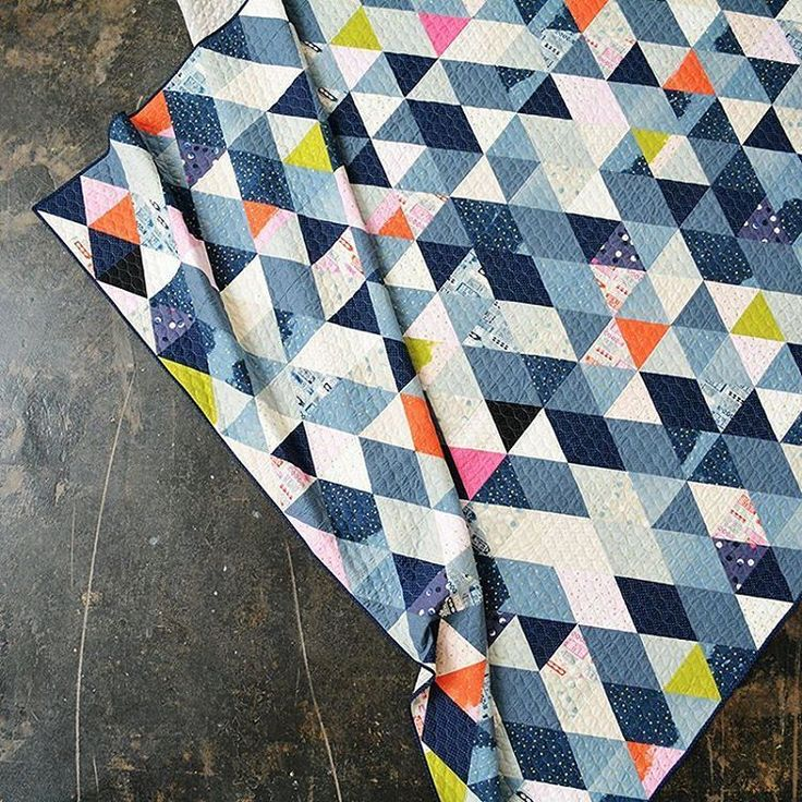 Free pattern alert! The Jubilee quilt is a queen-sized triangle stunner. You can get to the pattern via our lookbook (link in bio) and clicking on the link in the Jubilee section. #jubileefabric #cottonandsteel #quilting #sewing #freequiltpattern