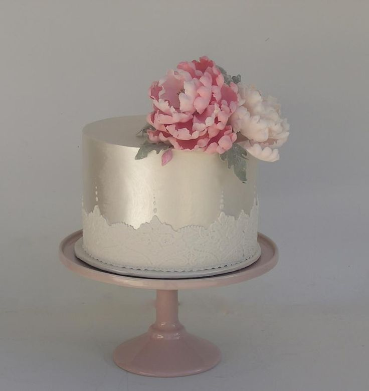 Shimmered pale gold cake with lace and peony detail