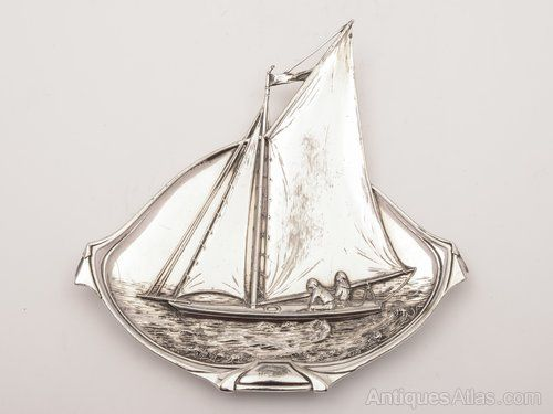 A lovely German WMF silver plate-on-pewter trinket dish of a sailing boat. There is no WMF mark, but there is a WMF pattern number: 264K. Circa 1900.