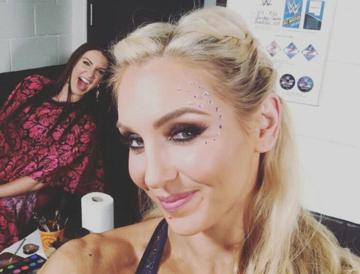 Charlotte getting photobomb by Stephanie McMahon