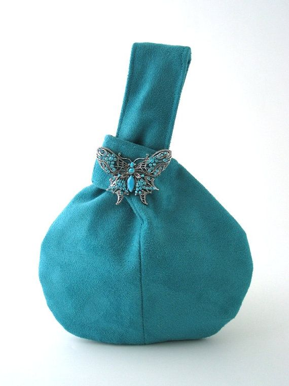 turquoise wristlet bag with butterfly broche blue by daphnenen