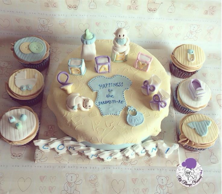 Baby Shower Cakes and Cupcakes - Chocolate Truffle Baby Shower Cake with Bibs, Baby Toys and Pacifier Fondant Decor with Chocolate Cupcakes | All Things Yummy  #allthingsyummy #babyshower #cakes #cupcakes #bibs #pacifier