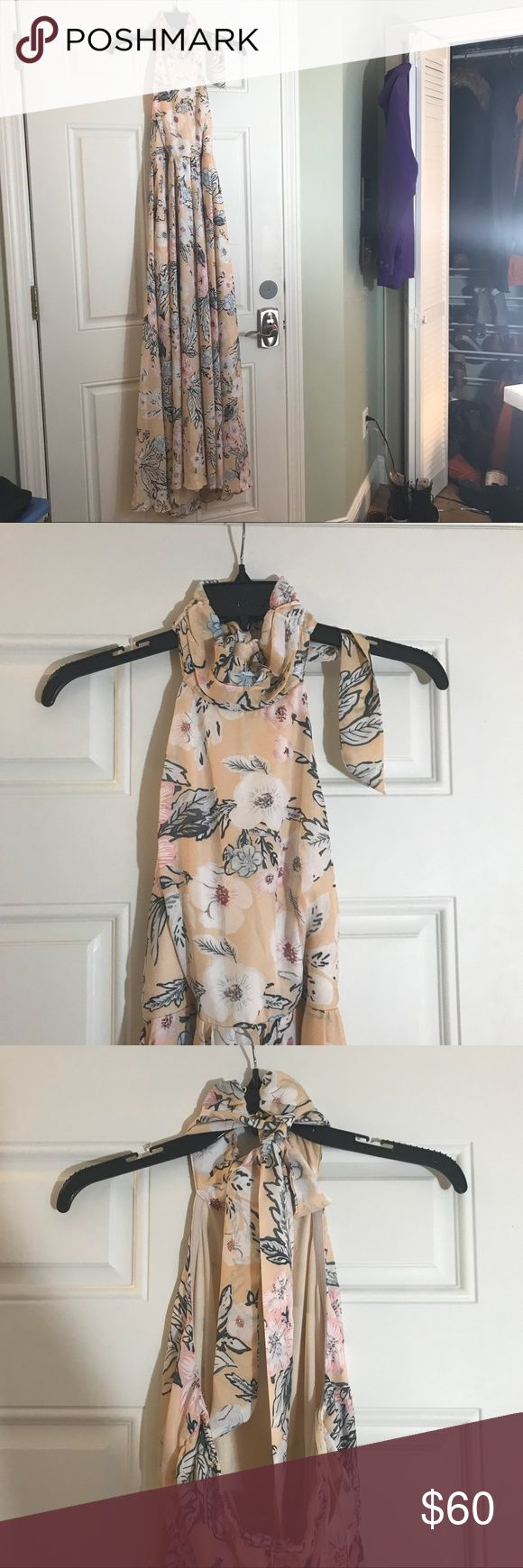 NWT Floral halter Maxi dress Beautiful halter maxi dress. Never worn. I'm obsess with it but it's too long for me. It's missing a button on the back of the neck but it also has a tie for the choker as well so it's still secure. New with tags: originally $89.95. Dresses Maxi