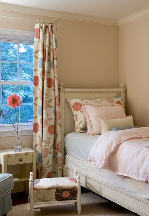 soo adorable for a little girl's room. Particularly like the drapes that match the pillow sham, and the great big flower on the simple bedside table.