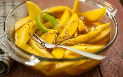 Pickled Mango Spears //  1.25 c. cider vinegar 1/3 c. honey 1 T. brown mustard seeds 2 tsp fennel seeds 3/4 tsp fine sea salt 1/2 tsp ground turmeric Peel of 1 lime, removed in wide strips with a paring knife or vegetable peeler 4 ripe but firm mangoes, peeled, pitted and cut into 8 spears each